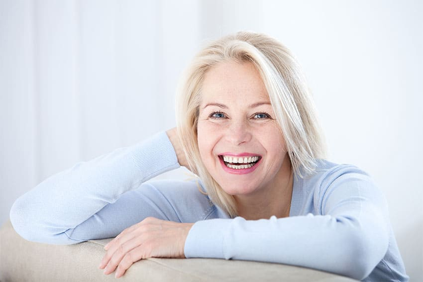 mature woman shows off her confident smile